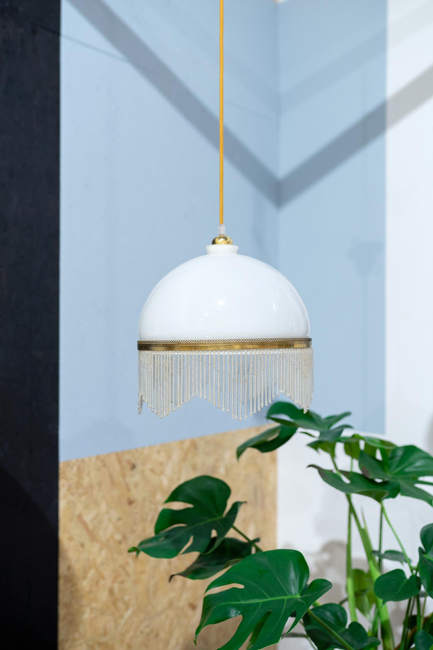 glazen lamp met kralen